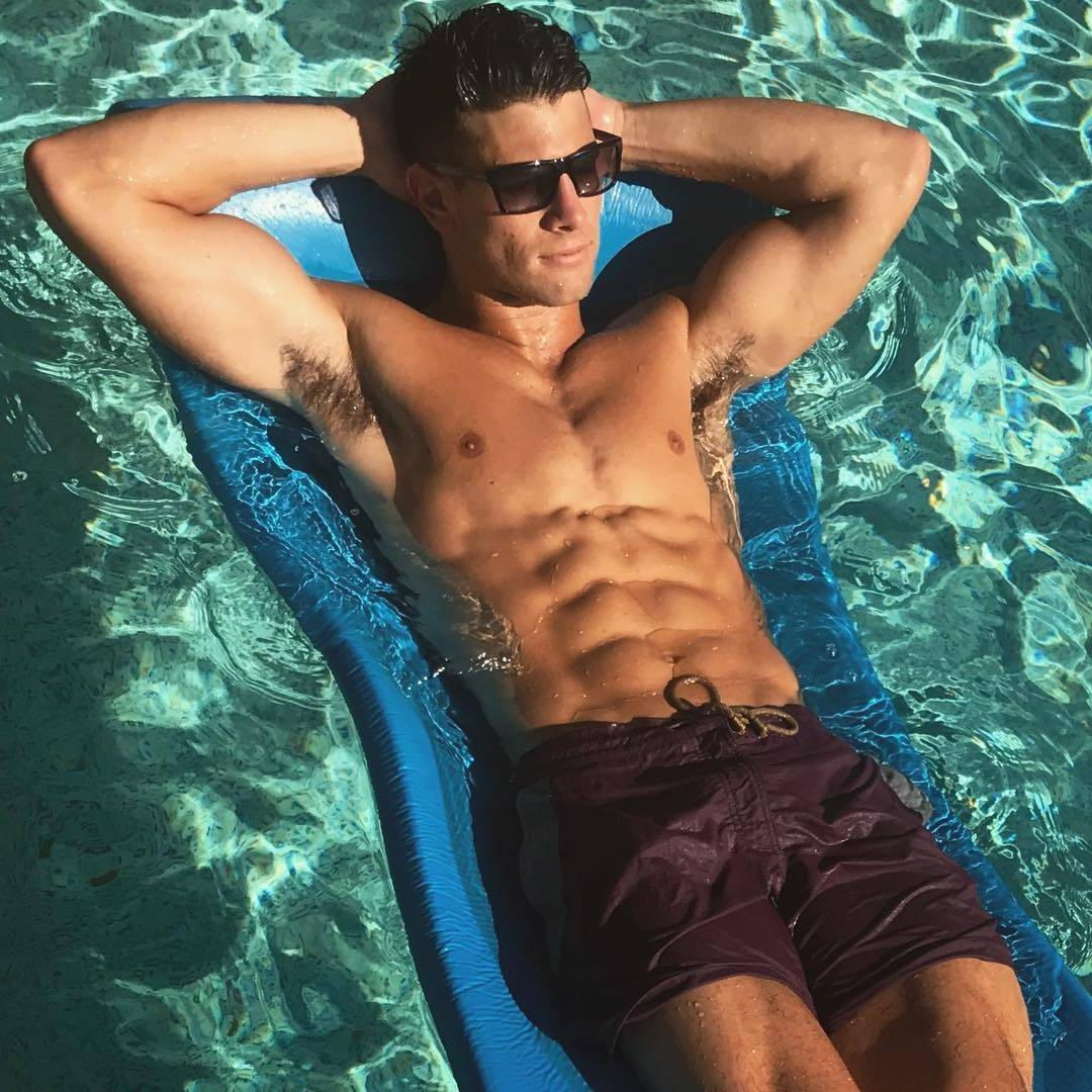 cocky-sexy-sixpack-abs-young-hunk-sunglasses-big-biceps-hairy-armpits-pool-relaxation