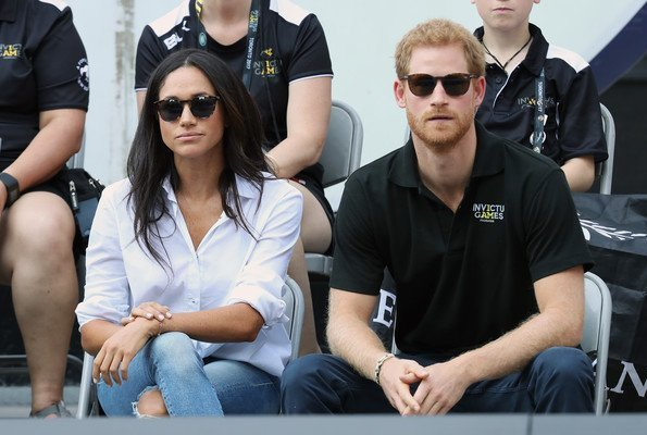 Prince Harry and Meghan Markle watched Wheelchair Tennis match. Style of Meghan Markle. wore a ice blue blouse and jeans