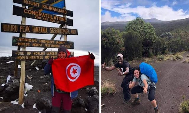 بالصور ... اول تونسية ترفع الراية الوطنية في أعلى قمة من جبال إفريقيا