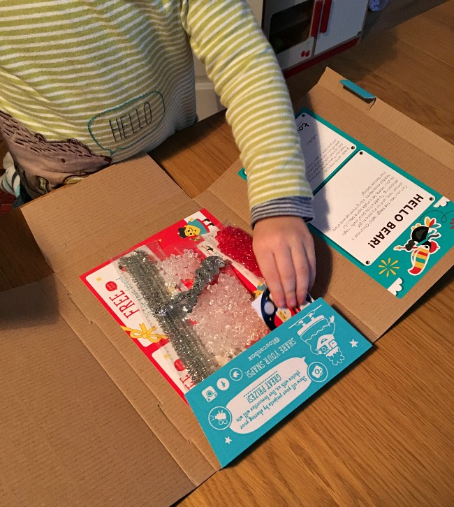 boys-hand-taking-contents-from-toucanBox-addressed-to-Bear