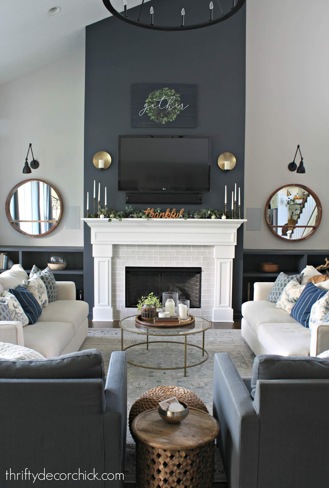 Symmetrical fireplace wall and family room with sofas