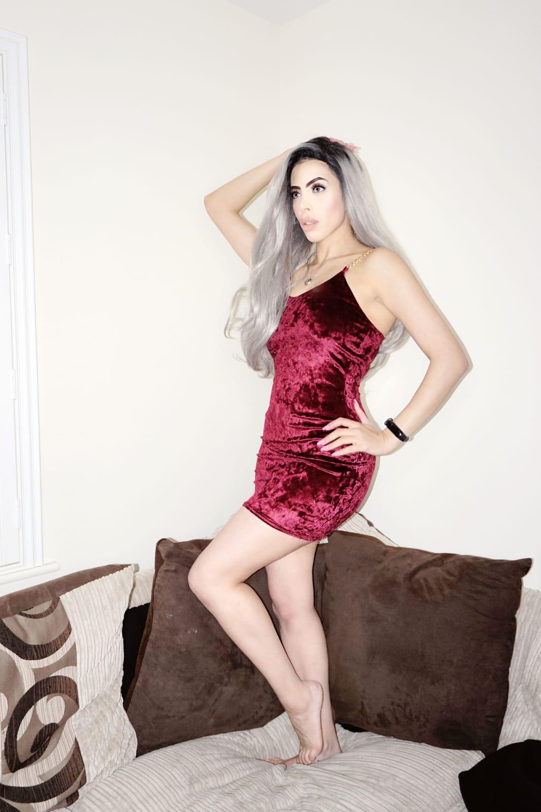 Femme Luxe Wine Velvet Bodycon Chain Strap Mini Dress in model Molly