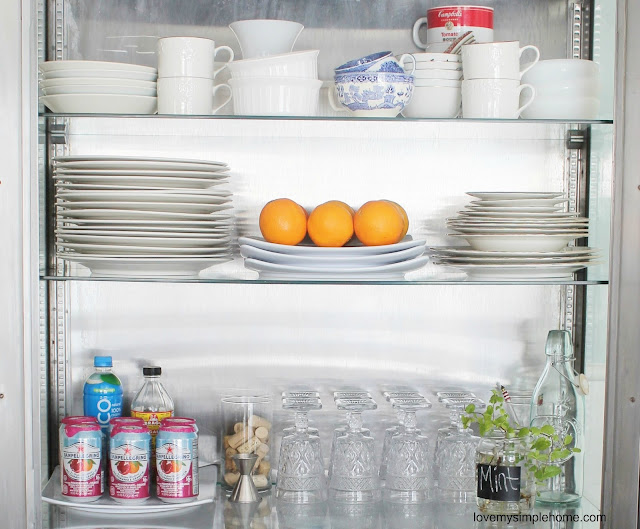organizing-ideas-for-glass-front-cabinets-love-my-simple-home