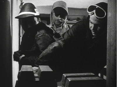 Still - Heist scene in Beast from Haunted Cave (1959)