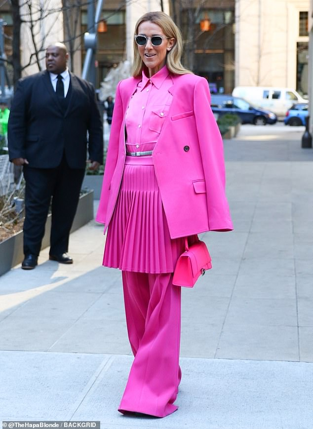 Celine Dion, 51, Displays her eye-catching neon pink four-piece creation as she steps out in New Jersey