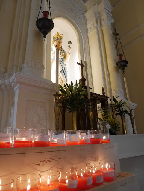 votive candles inside St. Dominic's Church in Macau