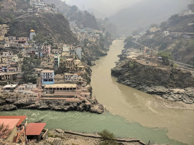 God blessing 2 rivers Bhagirathi and Alaknanda confluence in Devprayag / Religious tourist place in India