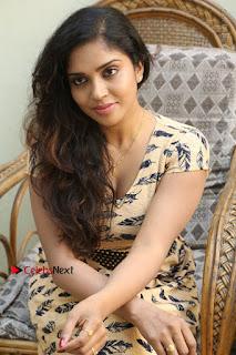 Telugu Actress Karunya Chowdary Stills in Short Dress at ATM Not Working Press Meet  0256.jpg