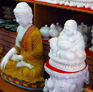 white jade Buddha with ruby dust and pure