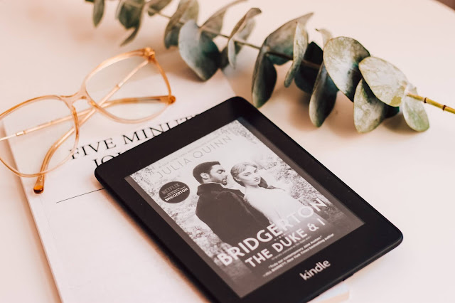A Kindle showing a Bridgerton book on the cover