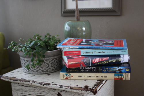 Stack of kids' books on a side table