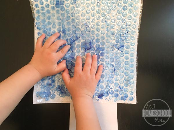 press down on the bubble wrap to make a good print - the popping is just for fun!