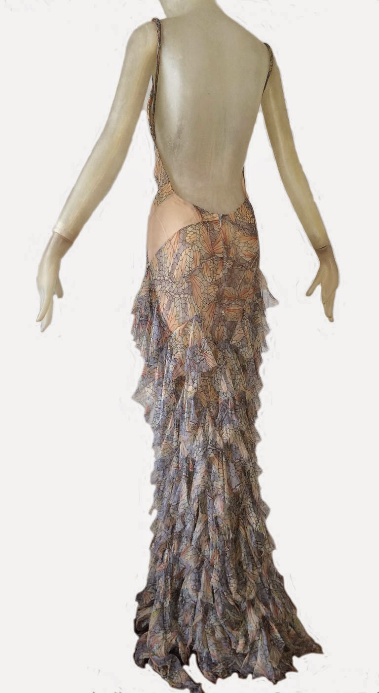 74dcaf340494 The dress has torn bits of silk chiffon squares sewn onto the bias of the  skirt. The patch work bodice has inserts of sheer nude silk chiffon and the  ...