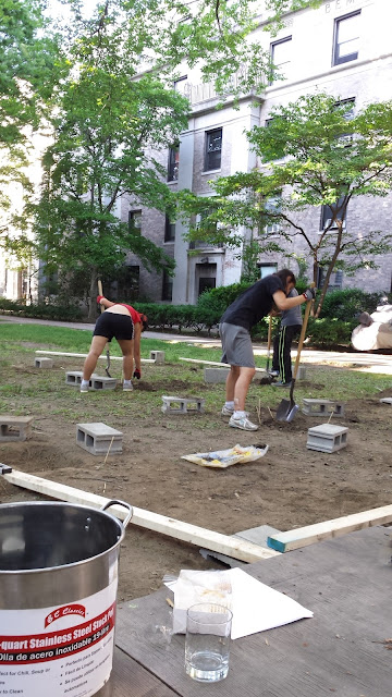 three students digging with shovels