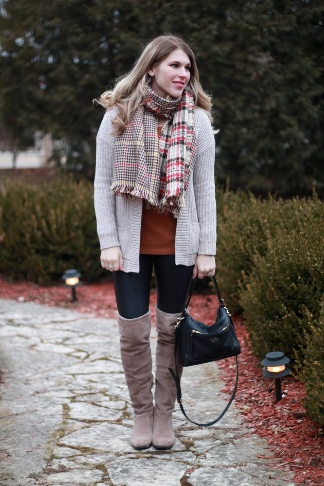 reversible plaid scarf, Spanx leather leggings, orange top, oatmeal knit cardigan, Kate Spade crossbody bag,