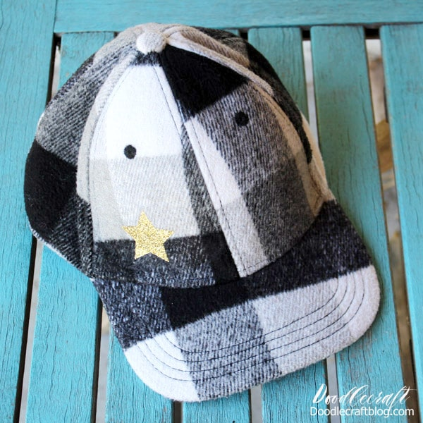 Make a Glitter Star Hat with the new Cricut EasyPress Mini in just 5 minutes. Black and White Buffalo plaid wool ball cap with gold glitter heat transfer vinyl star. Great for doll clothes, sleeves, stuffed animals and more!