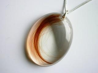 keepsake oval pendant for a lock of hair