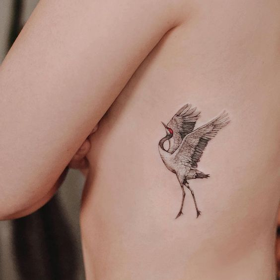 What is the meaning of the crane tattoo pattern