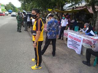 Tak Gentar!!! Gabungan Polres Enrekang dan Dinkes Galakan Operasi Yustisi di Pasar Kabere