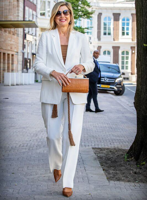 Queen Maxima wore a new white plain blazer suit from Massimo Dutti, and brown silk blouse