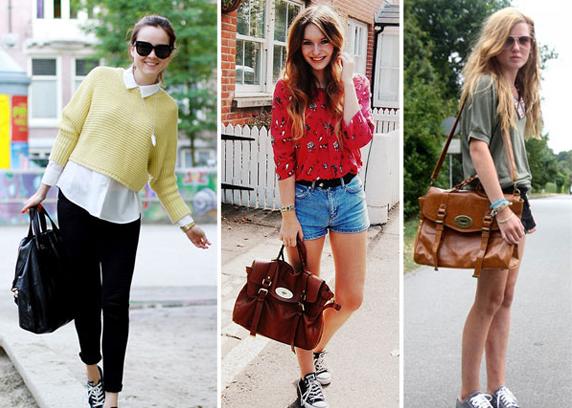 Fashionistas usando bolsas vintage estilo carteiro com look atual.