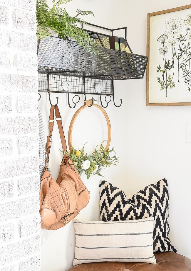 Vintage quilt hoop wreath in mudroom
