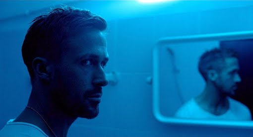 A sexy picture of Ryan Gosling with his face reflected in a mirror.