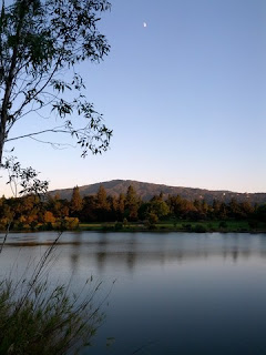 Moon above Vasona Lake as dusk approaches