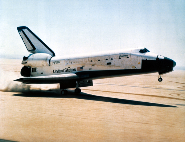 The orbiter Columbia touches down on Runway 23 at Edwards Air Force Base in California...successfully completing the first space shuttle mission, STS-1, on April 14, 1981.