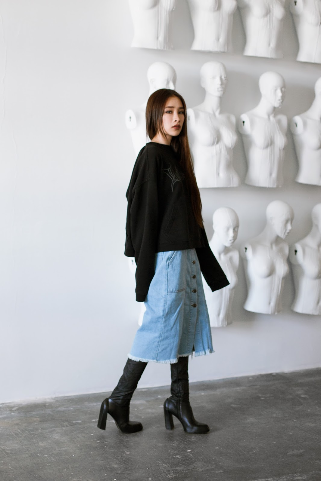 From an easy yet cool outfit, I paired the Vetements hoodie with a  button,front denim skirt and Ann Demeulemeester thigh high boots