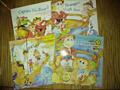 Four of the books from the Captain No Beard series by Carole P. Roman