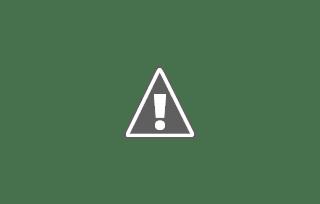 Fotografía de dos personas mayores bebiendo vino