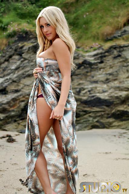 Ashley Emma lifting her dress on beach