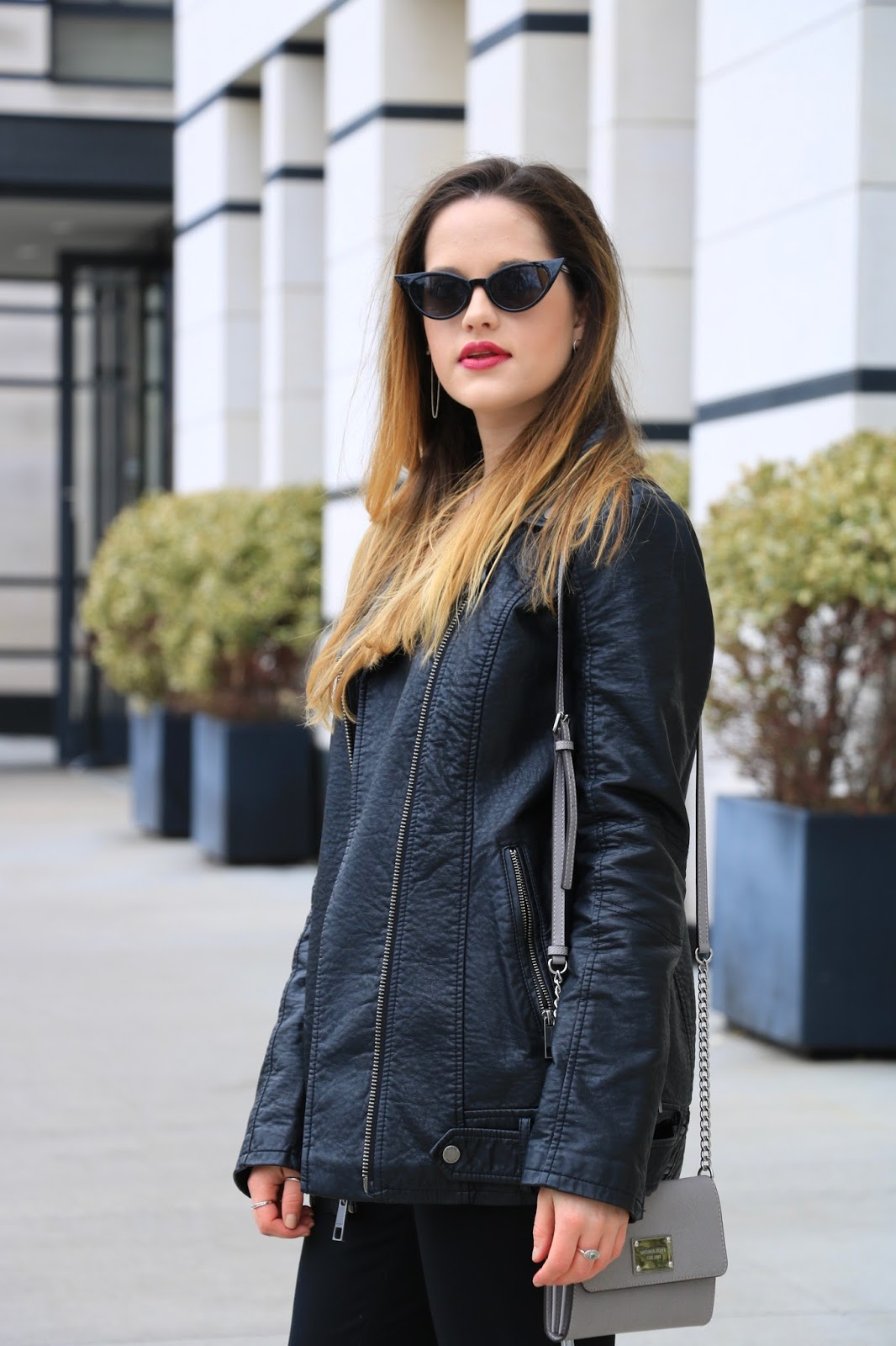 Nyc fashion blogger Kathleen Harper wearing an oversized leather jacket