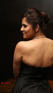 Telugu Anchor Actress Anasuya Bharadwa Stills in Strap Less Black Long Dress at Winner Pre Release Function  0027.jpg