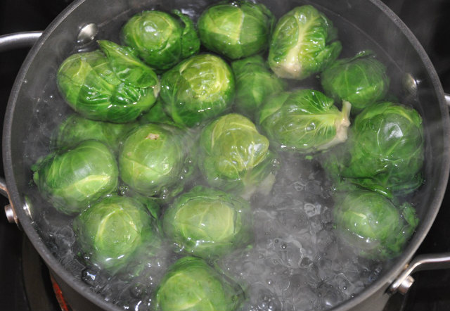 blanche Brussels sprouts in hot water