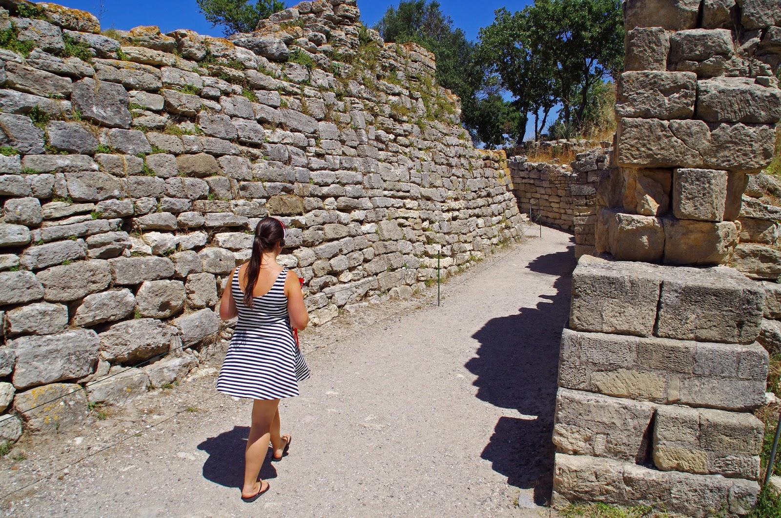 Girl walking through Troy ruins