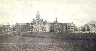 A black and white photo of a large, stately building when it was a lunatic asylum.