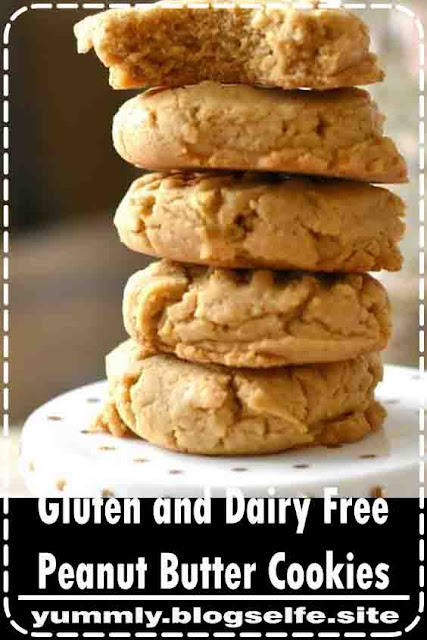 These are some of the best gluten free peanut butter cookie recipes that is easy, chewy and delicious! I love these gluten and dairy free easy peanut butter cookies as one of my Christmas cookie recipes. They are perfect for gluten free cookie exchange parties. #glutenfreecookies #easypeanutbuttercookies