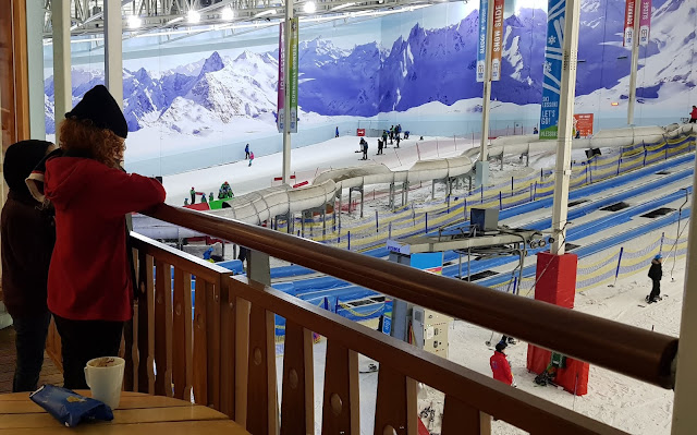 Bar and Cafe Balcony at Chill Factorᵉ overlooking slopes and snow park