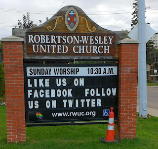 Robinson-Wesley United Church sign with rainbow flag in corner. Photo by rob g.