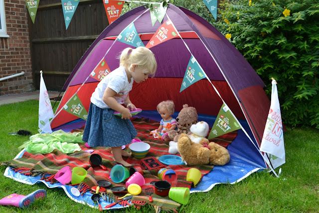 Tin Box Tot having a teddy bears picnic in a tent