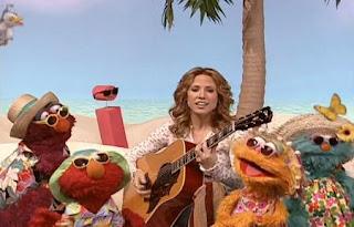 Sheryl Crow, Elmo, Zoe, Telly and Rosita sing I Soaks Up the Sun. Sesame Street All Star Alphabet