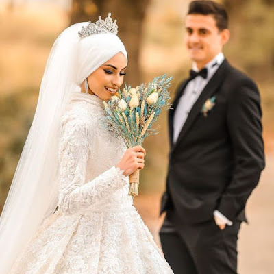 صور عروسة مع عريس بالفستان الابيض.