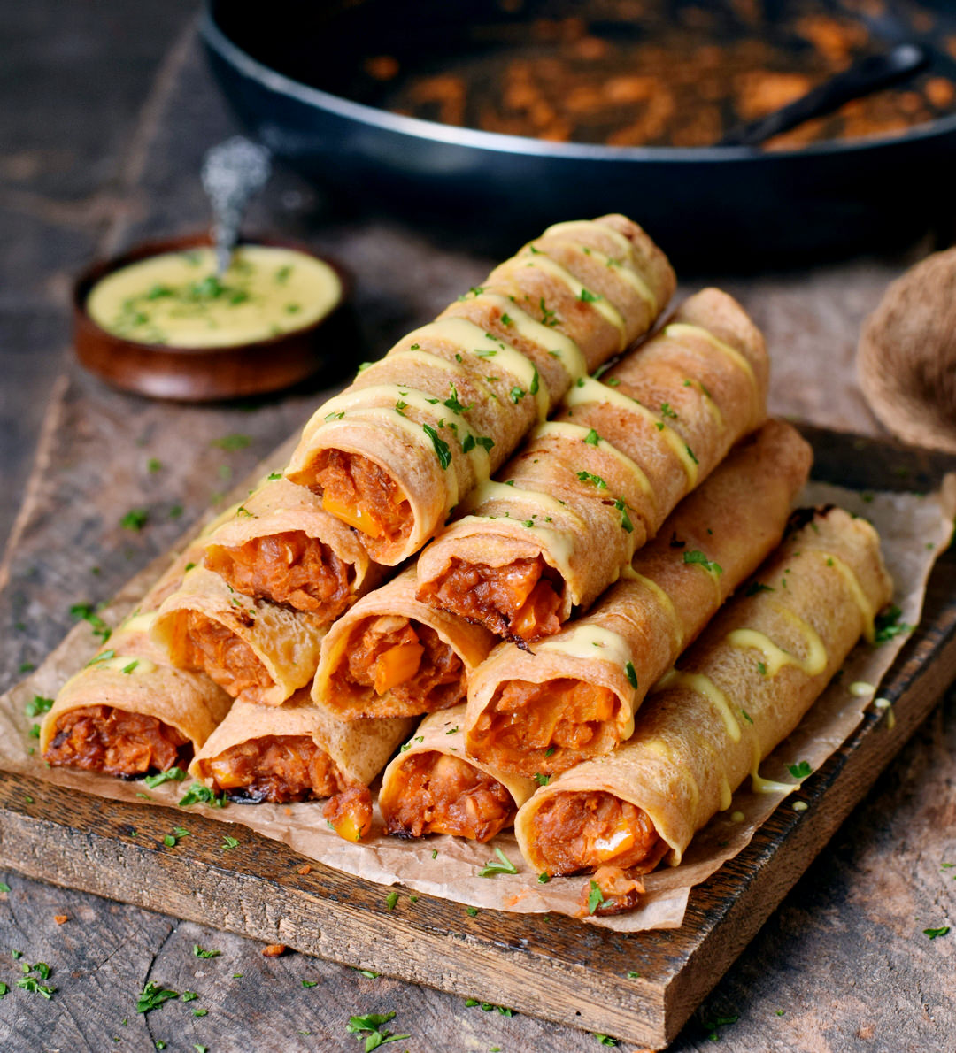 These Buffalo Chickpea Taquitos are crispy, spicy, and satisfying! No chicken needed for this protein-rich and delicious recipe. The taquitos are gluten-free, vegan, and easy to make!