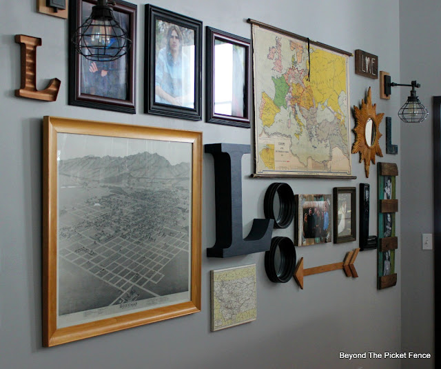 use old maps and photos and other vintage items to create a gallery wall