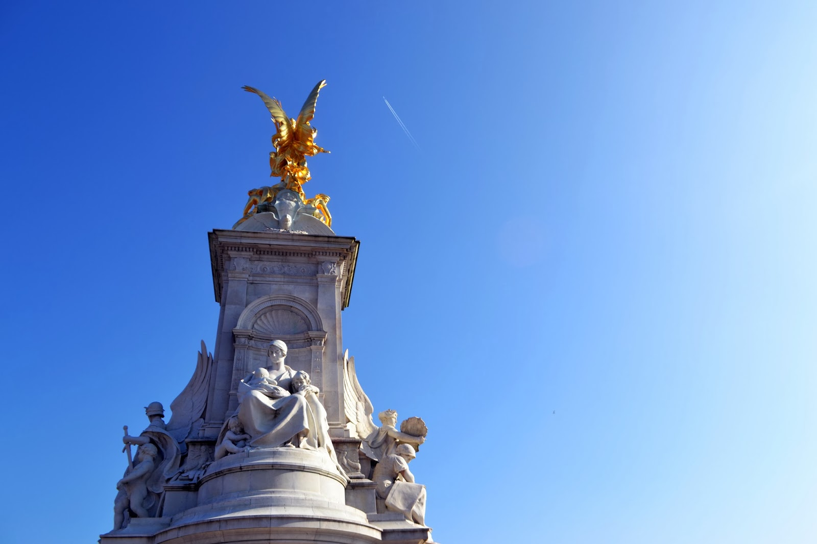 the top of the Queen Victoria Memorial. a golden bird can be seen on top.
