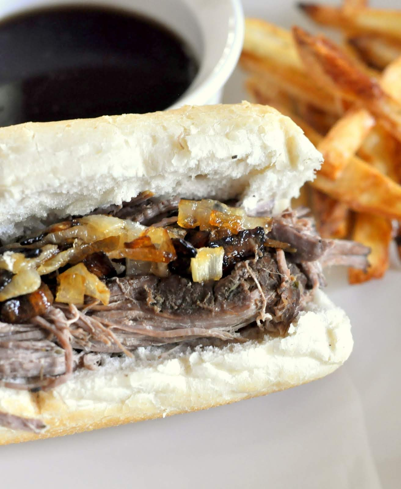 French Dip Sandwiches made in the slow cooker -- get the recipe on Taste As You Go!