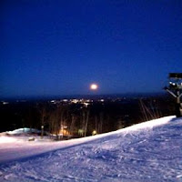 Night skiing at West Mountain Ski Center under a rising moon.  Photo courtesy of West Mountain.