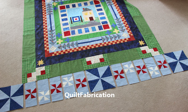 red and white pinwheels dancing in a quilt border